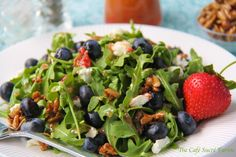 The Café Sucré Farine: Arugula & Blueberry Salad w/ Goat Cheese, Honeyed Sunflower Seeds & Strawberry Vinaigrette.