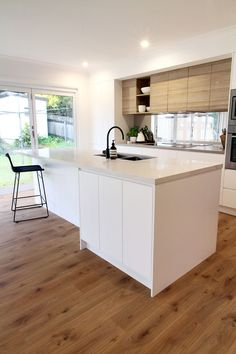 polytec doors in Natural Oak Ravine and Caesarstone benchtop Calacatta Nuvo