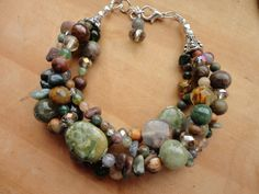 four strand earth tone brown and green gemstone bracelet, beaded multi strand bracelet, adjustable stone bracelet, silver beaded bracelet.