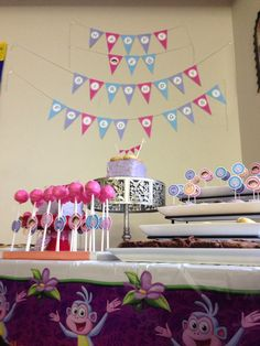 Dora Themed Dessert Table for twin girls 2nd birthday. Banner included ;) cookies, mini cupcakes, cake pops, mini cakes