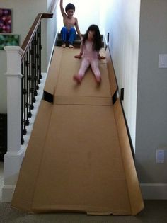 27.) Transform an old box into an indoor slide.
