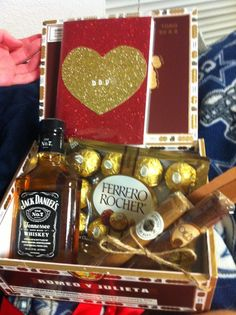 """Manly Valentine's Present for the Boyfriend: Made with love photo album with photos, quotes about love, and funny/cute sayings inside, bottle of Jack, chocolates, and cigars. All in a decorative """"Romeo y Julieta"""" cigar box and tied up with a silky red ribbon. Handsome, thoughtful, and affordable gift. He loved it! Instagram: peytonfrank"""