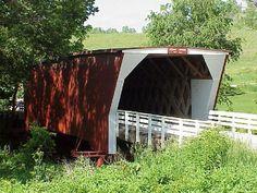 (Cedar or Casper Covered Bridge, 77', 1883, Town lattice, flat roof, rebuilt 09-2004, 15-61-03 #2) across Cedar Creek NNE of Winterset, Union Township, Madison County, Iowa. IA92 E. 0.5 miles from jct with US169 on the N. side of Winterset, N. on Cedar Bridge Rd. 1.8 miles to the bridge. (6-6-01, N41 21.915 W93 59.414)