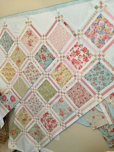 Looks like a finished with nine-Patch blocks as sashing cornerstones. This allows you to use a layer cake and cut each square into an 8 square and 1 strips for sashing and nine-patches.Most Beautiful Quilt Very pretty mix of fabricsLittle roses quilt Layer Cake Quilt Patterns, Layer Cake Quilts, Layer Cakes, Scrappy Quilts, Easy Quilts, Mini Quilts, Shabby Chic Quilts, Vintage Quilts, Vintage Star