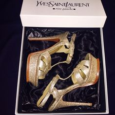 Yves Saint Laurent YSL Tribute 105 Sandal Vulcano 100% authentic sought after Tribute 105 sandals in a beautiful gold cracked leather. Shoes have been professionally resoled (were to slippery to walk with on smooth surfaces without.) The shoes are in like new condition aside from small scuff on bottom of heel as seen in the last picture (the lifted leather was fixed back onto the shoe by the cobbler.) These beauties come with the original box and dust bag. Bought in Nordstrom as soon on the…