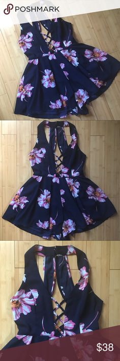 FLORAL PRINT ROMPER Floral Print Convertible Romper! A stunning navy blue, pink, white, and orange floral print blooms. Fits beautifully around bodice while fluttering shorts give the illusion of a dress. Condition: Worn once, excellent condition. Pants Jumpsuits & Rompers