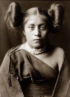 """Here for your consideration is an aesthetic picture of a Tewa Indian Girl. It was created in 1906 by Edward S. Curtis.    The photograph presents A Tewa girl, in a half-length portrait, facing front, with her hair arranged in a """"squash blossom"""" fashion."""