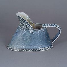 Walter Keeler     Small stoneware leaning jug (ca.1995), blue salt-glaze with green interior (H 13cm, W 20.5cm, D 10cm).