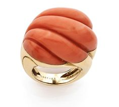 A CORAL AND YELLOW GOLD RING BY CARTIER. CIRCA 1980