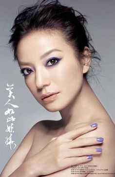Vicky Zhao, Chinese actress, with purple eye makeup.