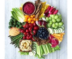 Veggies & fruit. Platter that would look lovely for about any gathering. Nice presentation.