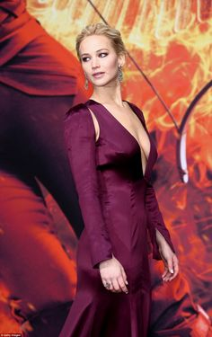 Striking: Jennifer made the most of her fabulous figure in the low-cut purple gown with elegant long sleeves