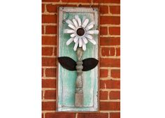 tin cans and other junque=cute! upcycled garden flower plaque