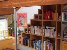 Stairs storage combo. Very nice. Jose & Oliver's Lofty Living in London