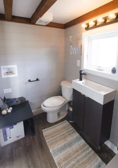 A 255 square feet tiny house on wheels in Nanaimo, British Columbia, Canada, built by Rewild Homes.