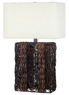 Rustic in design, the Whistler Table Lamp features an intricately woven rattan base that's sure to draw attention.