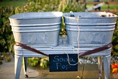 galvanized tubs for drinks at a rustic outdoor wedding