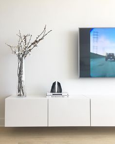 Clean lines & modern simplicity- this floating media console was the perfect addition to this chic living space!