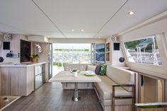 An interior shot of the convertible saloon of Sunsail's 404 catamaran.