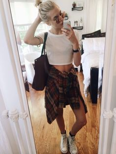 White crop top + flannel around the waist + high tops + high bun + shades