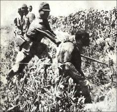 Chinese beheaded by Japanese officer - The Nanking Massacre or Nanjing Massacre, also known as the Rape of Nanking