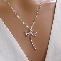 Dragonfly necklace in sterling silver. This graceful and simple dragonfly pendant looks so pretty on and makes a great everyday necklace. The dragonfly symbolizes change which makes this necklace a…MoreMore  #SilverJewelry