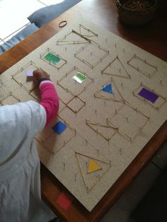 Large geoboard with cut shapes added