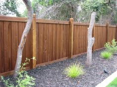 Custom wood privacy fence by Mossy Oak Fence.