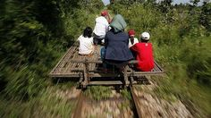 Cambodians ride a bamboo train near a reopened station in Pusat province in 2010.