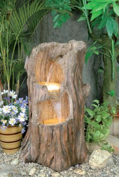 Tree Stump Cascade Water Feature With Lights  This realistic tree stump cascade is in fact made from durable and frost resistant polyresin. A beautiful self contained water feature that comes with everything you need to get it working immediately, just add power and water.  N