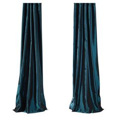 Bring a stylish touch to your windows with this faux silk curtain, featuring a Mediterranean hue.  Product: Curtain panel
