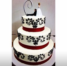 Red, black and white cake. Ribbon. Swirls.  www.mazzettisbakery.com Mazzetti's Bakery. Pacifica, CA. Family owned bakery. Bay Area bakery. Desserts. Cupcakes. Baked treats.  Wedding cakes and cupcakes. Desserts for special occasions.