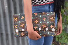 A personal favourite from my Etsy shop https://www.etsy.com/in-en/listing/271452107/black-cross-stitch-handmade-clutch