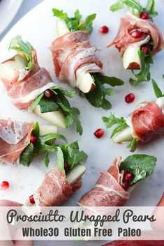 holiday appetizers A super simple and Paleo appetizer for holiday parties and get togethers, these prosciutto wrapped pears are the perfect blend of sweet and salty. With just a drizzle of olive oil on the peppery arugula, it becomes rich and delicious! No Cook Appetizers, Gluten Free Appetizers, Thanksgiving Appetizers, Christmas Appetizers, Appetizers For Party, Delicious Appetizers, Light Appetizers, Appetizer Ideas, Thanksgiving 2020