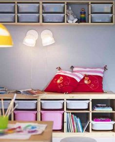 Ikea Trofast Low Unit with Wall units for extra storage & books on top.