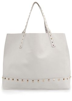 Blanco puro: El bolso it de las mujeres con estilo BOLSO SHOPPER CON TACHUELAS DE MANGO