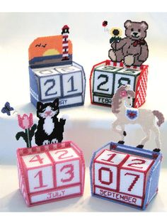 """Three cubes display the date and month with graphs for 4 different backgrounds, so you can express your own personality. Can be made from either 10-count canvas and sport-weight yarn for smaller spaces (finished size: 4"""" wide x 2 1/2"""" deep ..."""