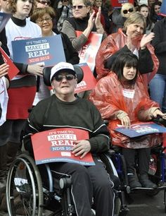 Hundreds rallied outside Parliament in Hobart in support of the National Disability Insurance Scheme.