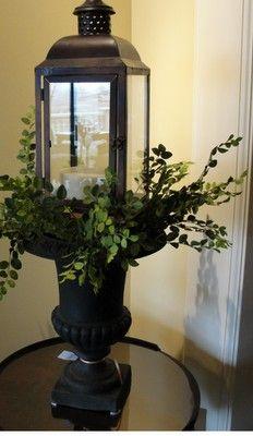 Urn, lantern,greenery