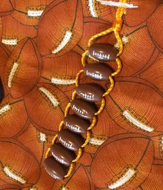 Football Fidget Beads. Any beads could be attached this way. Fidget Quilt Sensory Blanket for Alzheimer's by thefairyfeltmother