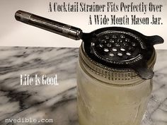 You can use a cocktail strainer in a wide mouth mason jar!
