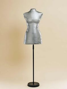Making a homemade dress form of your own body with duct tape, pillow stuffing, a tshirt and a metal stand. Brilliant.