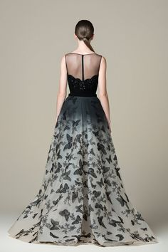 Long Jet Black straight-cut dress with an illusion boat-neck top and a beaded sweetheart base, an overskirt, and embroidered butterflies. Butterfly Wedding Dress, Party Wear Frocks, Saiid Kobeisy, Evening Gowns With Sleeves, Straight Cut Dress, Fitted Black Dress, Queen Fashion, A Line Gown, Formal Gowns