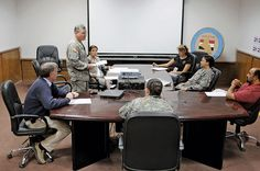 Human Terrain System leader and PRT members listen to briefing during meeting at Contingency Operating Base Speicher, Tikrit, Iraq U.S. Army (Raul Elliott)