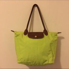Neon Longchamp Tote - Small Super fun neon on this classic tote. This tote does show wear (some wrinkles, dirt and the leather dye from the handles has bleed) but can still be used and this color is very hard to come by. This is the small size tote. No trades no PayPal Longchamp Bags Totes