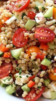 Israeli Couscous Salad with Summer Vegetables: 1 cup of Israeli couscous / 1 cup of water / ½ veggie bouillon cube - roughly chopped up / ¼ red bell pepper - finely diced ½ cucumber - peeled and seeded - finely diced:/ 1 cup of cherry tomatoes - sliced in half / 2 tbs red onion - minced / 1 handful of parsley - minced / 10 olives / 2 oz of feta / 3 T olive oil plus 1 t olive oil / 1 T red wine vinegar / 1 t honey - a small squeeze / 8 twists of black pepper