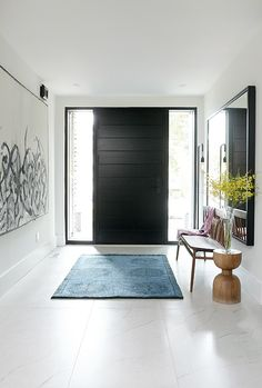 Design: Shirley Meisels, Mhouse, Inc. Decor, Modern Entrance Door, Diy Entryway Table, Front Door Decor, Small Entryway Table, Entryway Table Modern, Entryway Decor, Interior Design, Black Doors