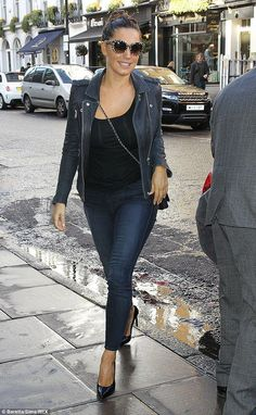 Switching it up! Earlier in the day she had a casual leather jacket on instead of her trench coat