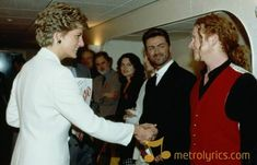 Princess Diana - shakes hands with singer Mick Hucknall of Simply Red at a rock concert for World AIDS Day at Wembley, London, December British film director David Puttnam (centre, left) and singer George Michael (centre, right) look on. George Michael, Mick Hucknall, World Aids Day, Princes Diana, Simply Red, Diane, Shake Hands, Rock Concert, Diana Spencer
