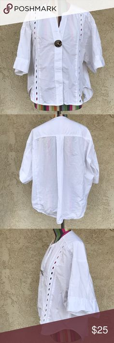 """Zara White Button Down Top 3/4 sleeve button down blouse with oversized button and lace detail. Wide/loose fit, high-low cut. Minor flaw on the shoulder has two tiny holes, other than that is in great condition. No stains.                                              Length (shoulder to bottom hem) front: 22""""                                                        Length (back): 29""""                                  Pit to pit (lying flat): 25"""" Zara Tops Button Down Shirts"""
